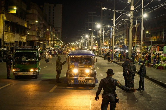 Police check vehicles in Manila during the coronavirus pandemic on March 18, 2020.