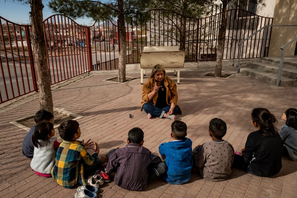 Psychologist Patricia Galarza leads a group therapy session about how to say goodbye to your friends with the children living at the San Juan Apóstol migrant shelter. The children will soon be separated from each other as the government starts processing asylum seekers under MPP into the U.S.