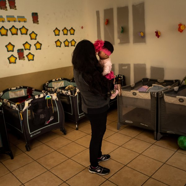 Xiomara plays with her baby in the nursery of the San Juan Apóstol migrant shelter. After fleeing gang violence in El Salvador, she arrived at the U.S.-Mexico border pregnant with her fourth child hoping to claim asylum. She gave birth in Ciudad Juárez, Mexico, with the help of volunteers.