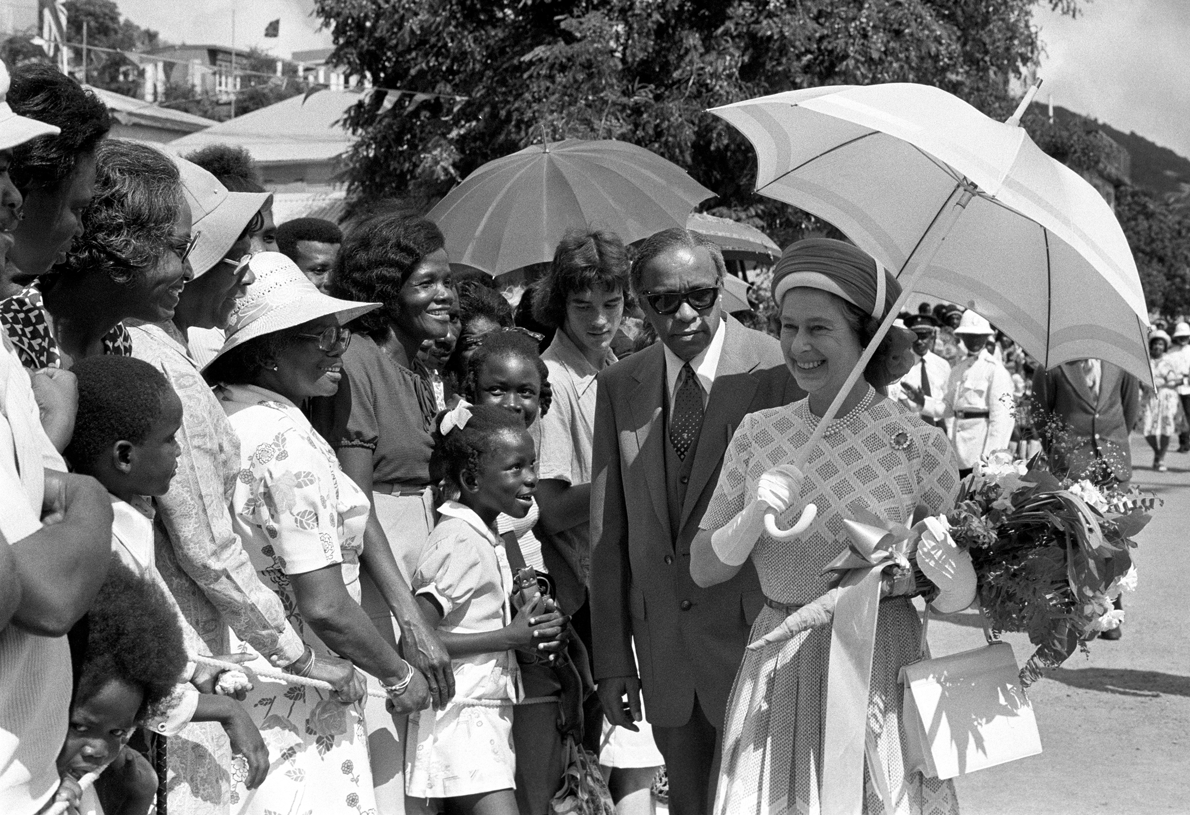 Queen Elizabeth II pauses for a word with local inhabitants in Tortola when she and the Duke of Edinburgh visited the British Virgin Islands as part of the Silver Jubilee tour of the West Indies, Oct. 1977
