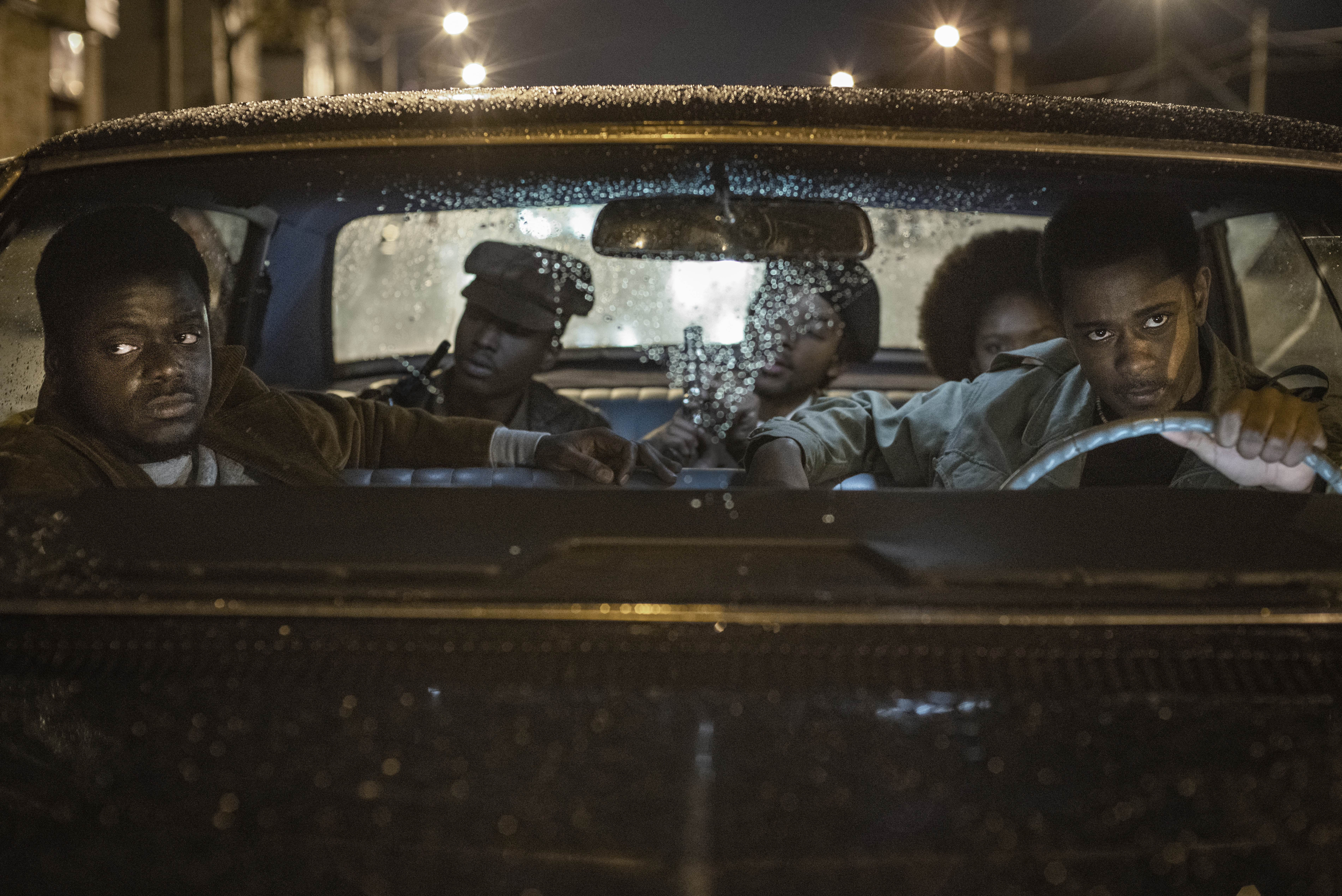 Daniel Kaluuya (in passenger seat) and LaKeith Stanfield (driving) in 'Judas and the Black Messiah'