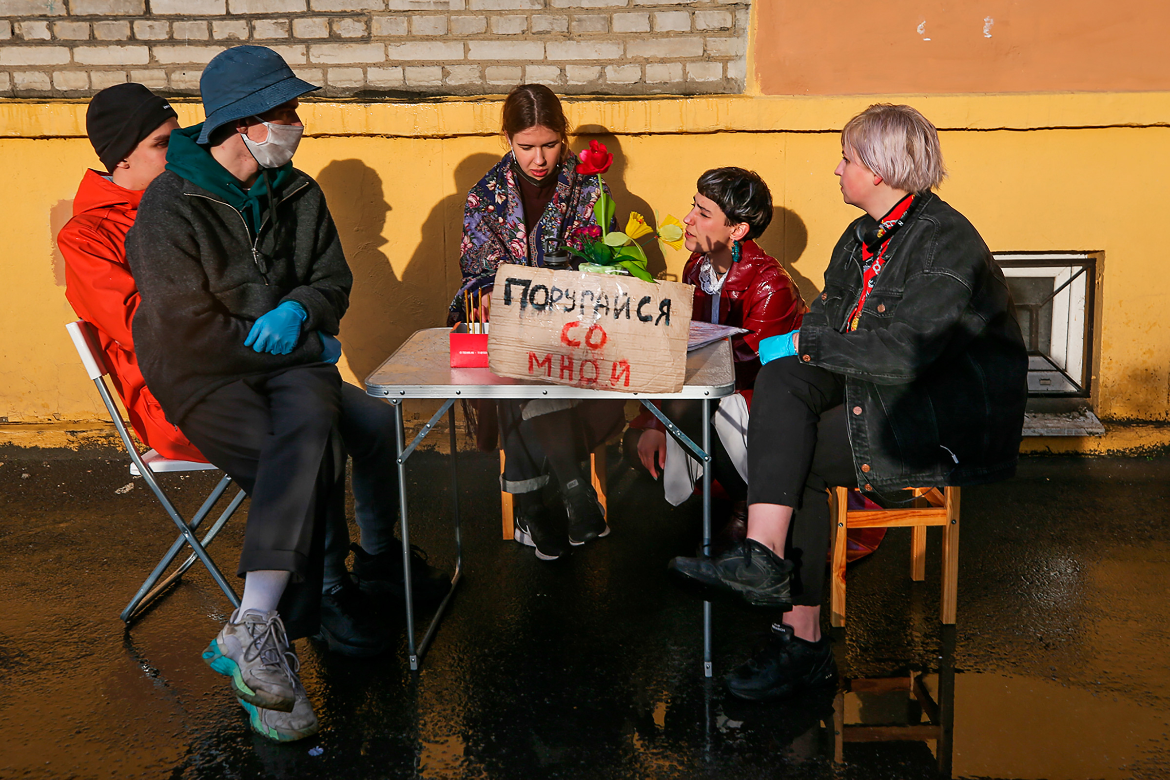 The art performance Quarrel With Me, shown in St. Petersburg in May, was organized by artist and activist Katrin Nenasheva, second from right, to address the topic of domestic violence during Russia's lockdown. In the performance, Nenasheva invites people to have a quarrel with her.