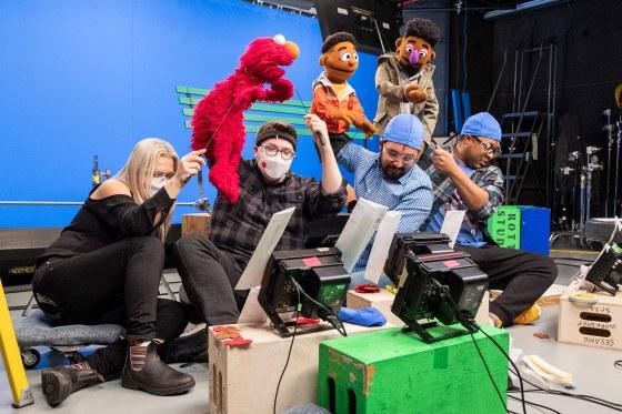 Puppeteers Carmen Osbahr (assisting for Elmo, she plays Rosita), Ryan Dillon (Elmo), Bradley Freeman Jr. (Wes) and Chris Thomas Hayes (Elijah) on set