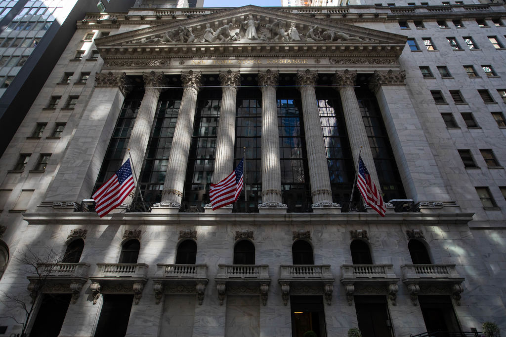 American flags in front of the New York Stock Exchange (NYSE) in the Financial District of New York, U.S., on Friday, March 5, 2021. Stocks climbed as technology shares rebounded from an earlier selloff.
