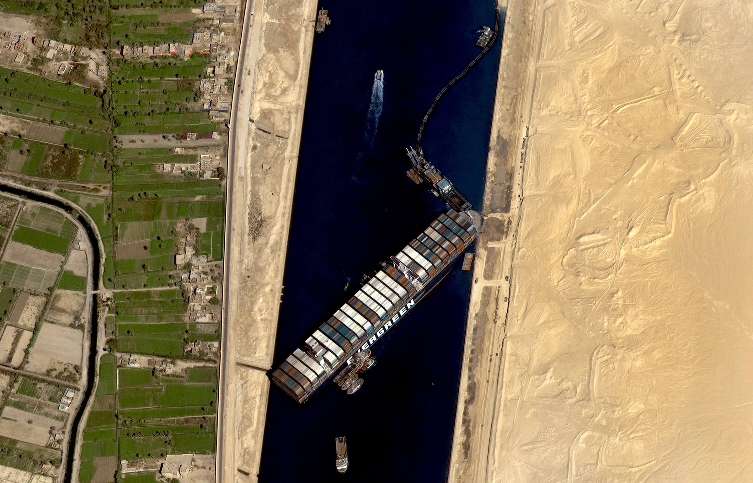 The stuck container ship 'Ever Given' on the Suez Canal, in Egypt, on March 27, 2021. Ever Given, a large container ship ran aground, in the Egyptian canal on Tuesday after being caught in gusty winds and a stand storm.