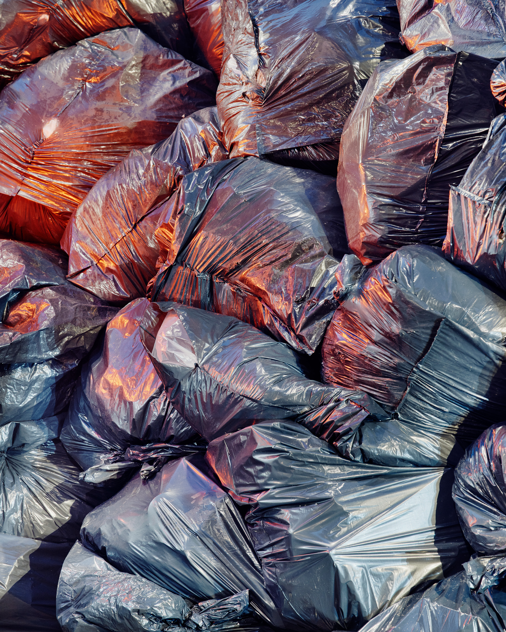 Trash bags pile up in Manhattan in January.