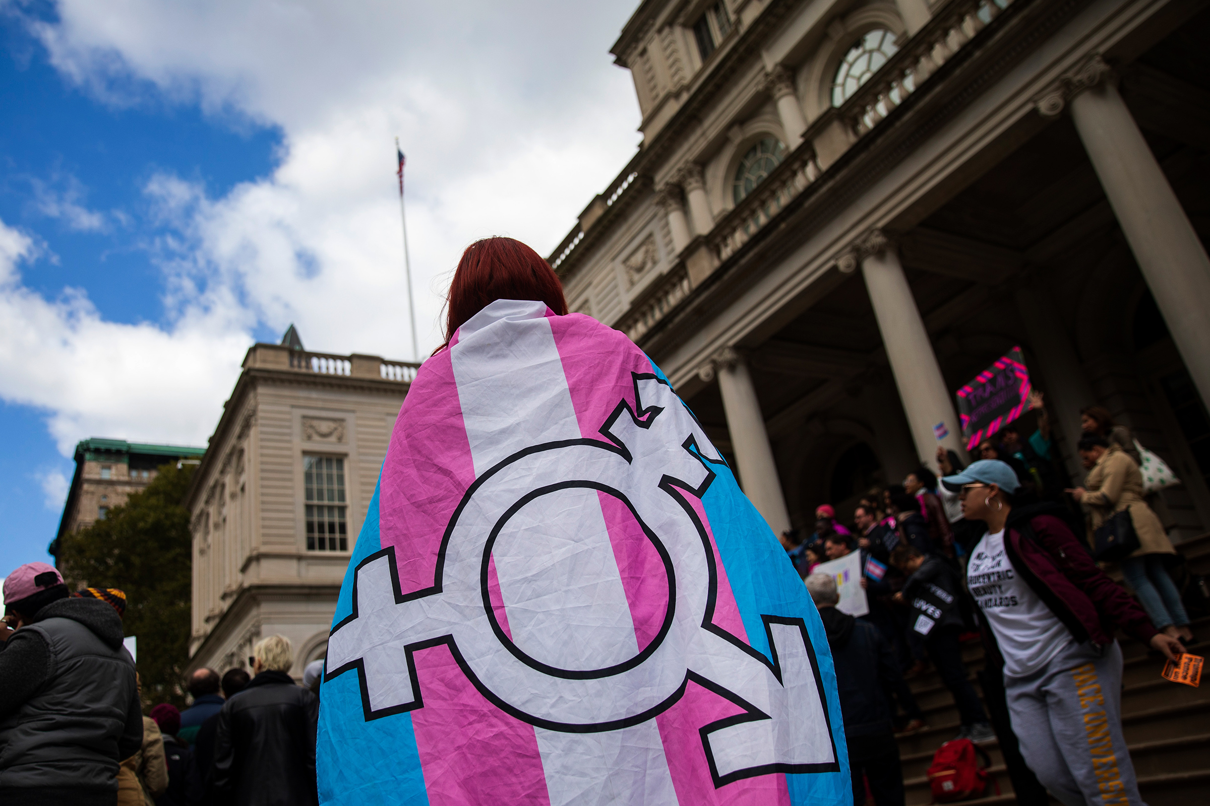 Activists and their supporters rally in support of transgender people on the steps of New York City Hall, October 24, 2018 in New York City.