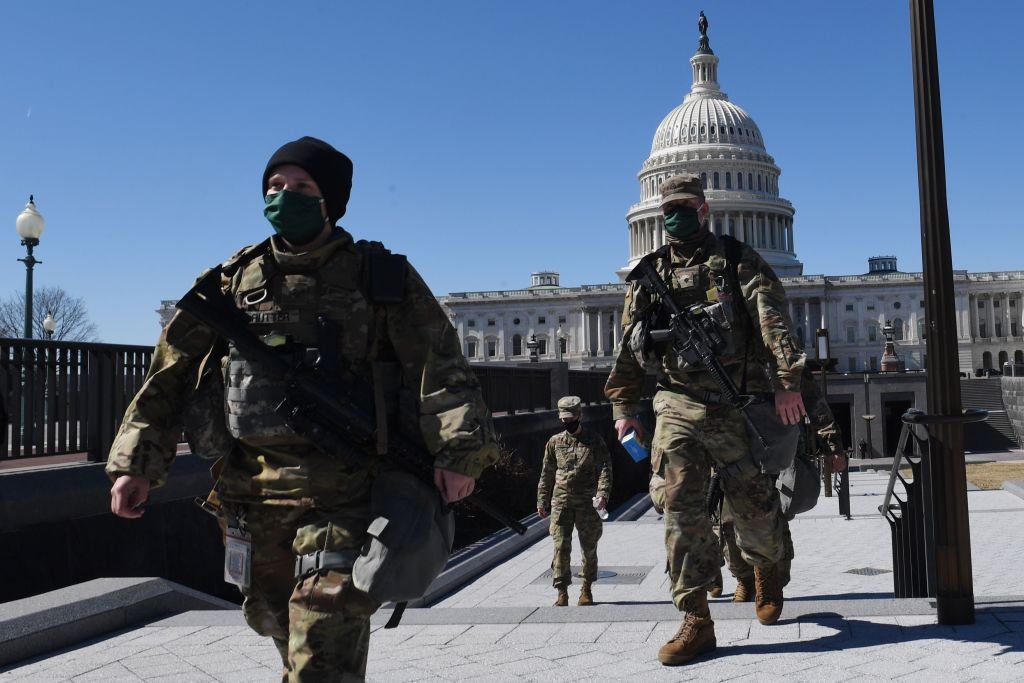 Members of the National Guard are seen walking near the US Capitol Building on Capitol Hill March 3, 2021, in Washington, D.C.
