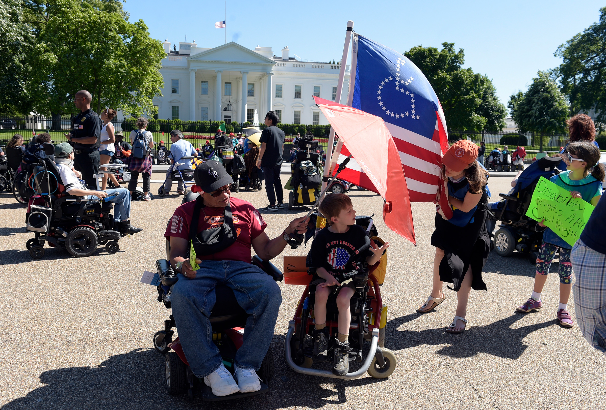 Protesters supporting people with disabilities gather outside the White House in Washington, May 15, 2017