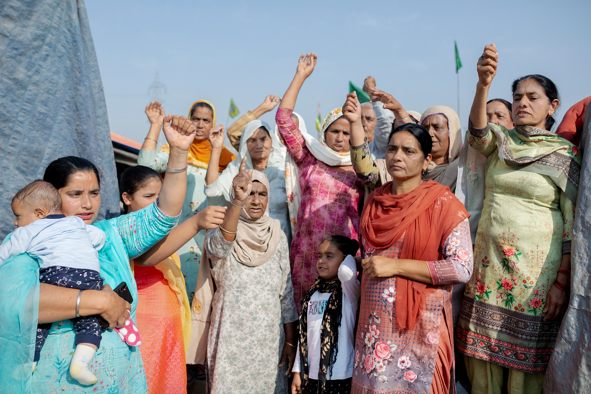 "Kiranjit Kaur, far left, came to the Tikri protest site from Talwandi, Punjab, on Feb. 23 with a group of 20 women, including her mother-in-law and children. ""It is important for all women to come here and mark their presence in this movement. I have two daughters, and I want them to grow up into the strong women they see here."""