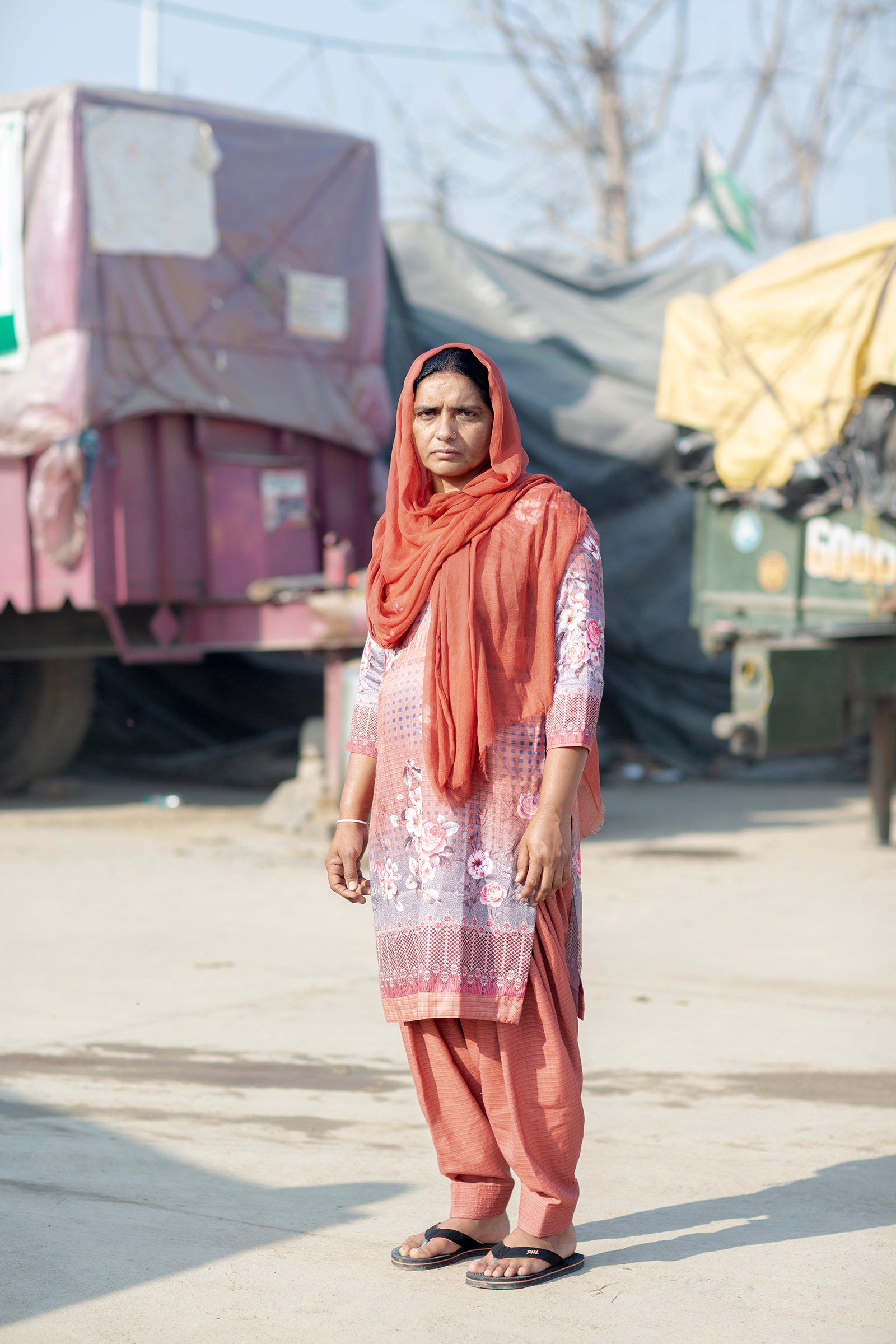 """Amandeep Kaur, 41, from Talwandi, Punjab, is employed as a community health worker and as a farmer to support her two daughters. Her husband died by suicide five years ago; because she did not know her rights, she didn't receive government compensation given to families of farmers who die by suicide. The new laws, she says, """"will kill us, will destroy what little we have."""""""