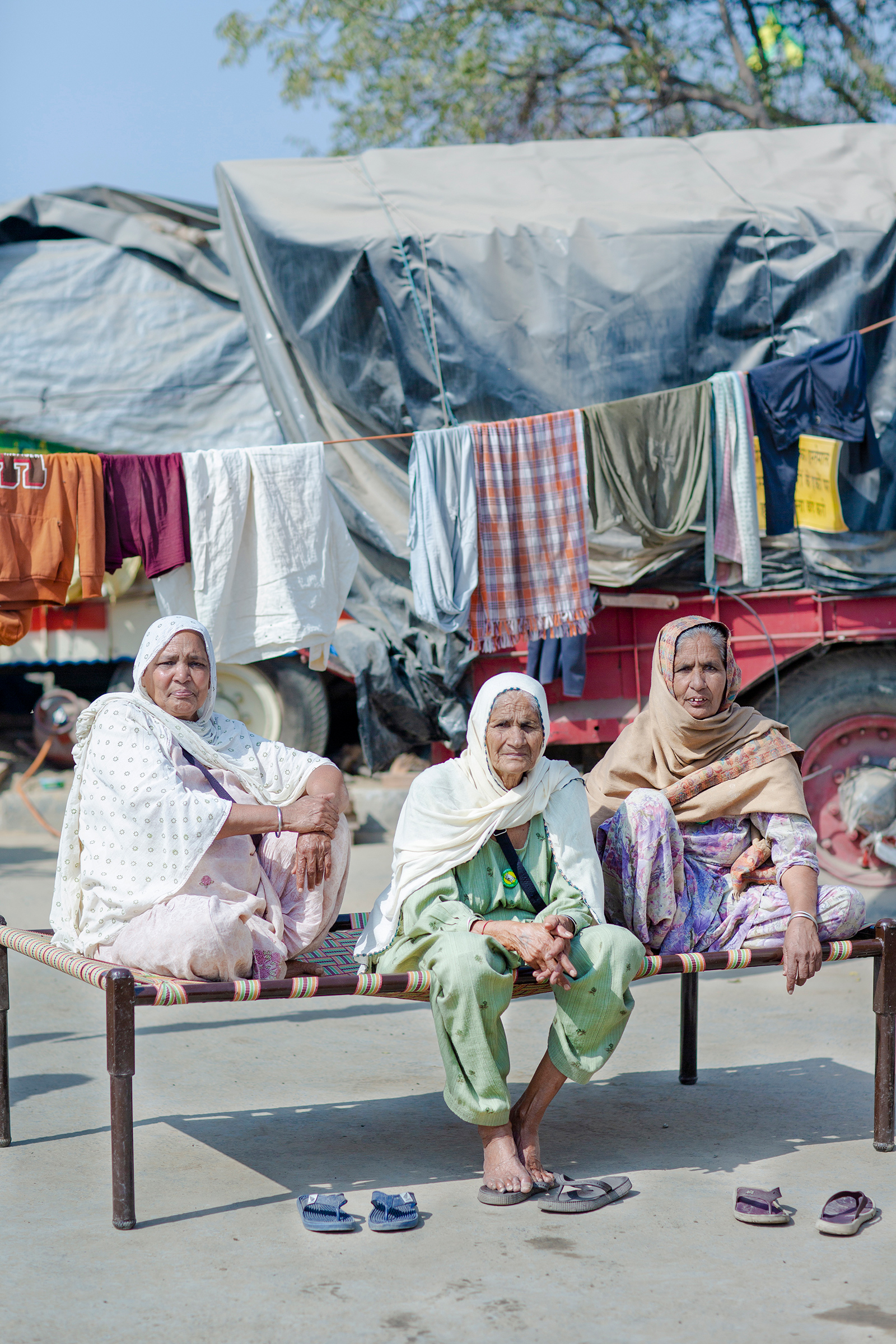 """The protests have drawn women of all ages. While some speak onstage, others are simply determined to be present. """"I am an illiterate woman,"""" says Gurmer Kaur, center, at the protests with her friends Surjit Kaur, left, and Jaswant Kaur, right, all in their mid-70s. """"I cannot talk well, but I can sit tight—and I will sit here till the next elections if these laws are not called off."""""""