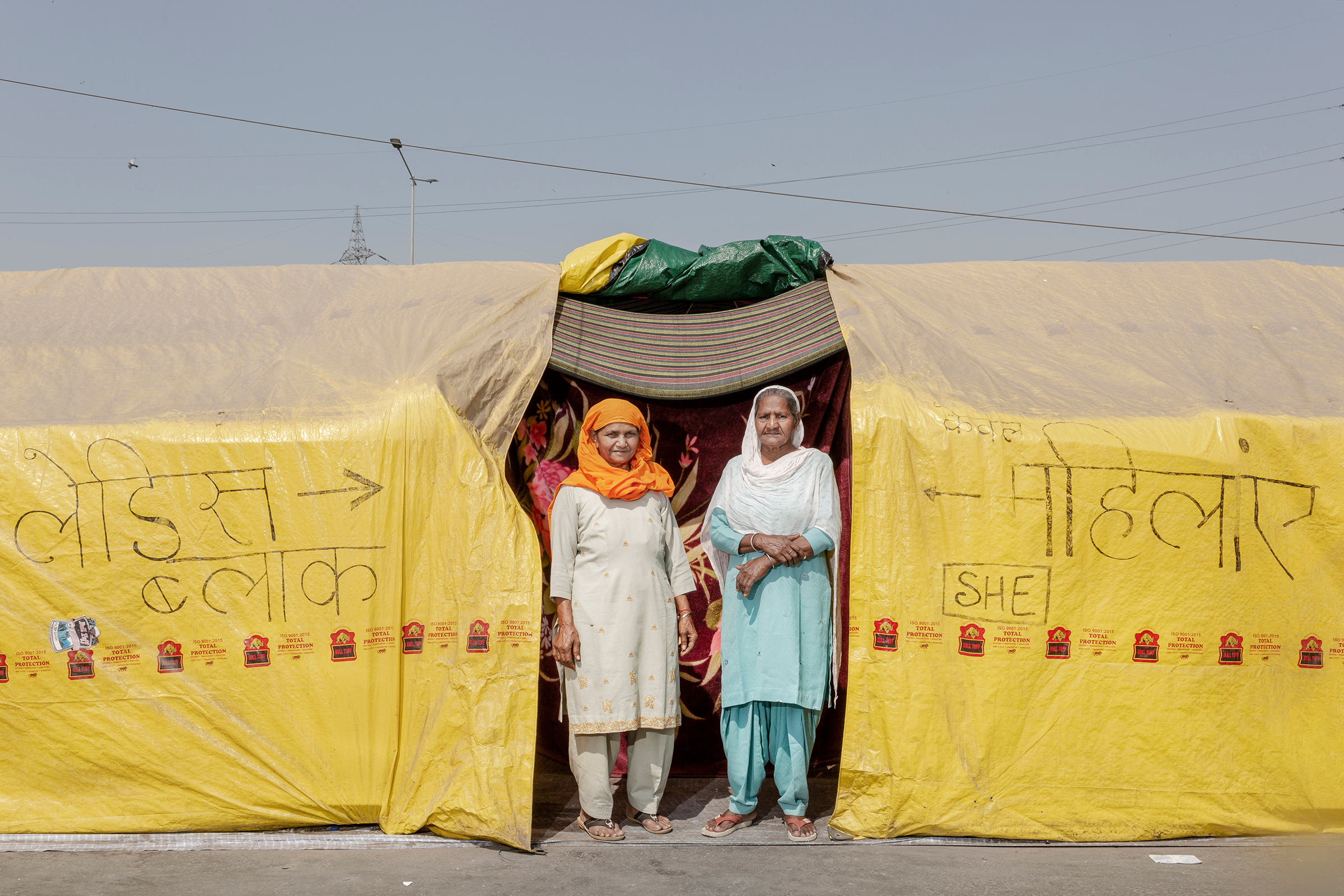 """Sarjit Kaur, left, and Dilbeer Kaur, right, from Rampur, Uttar Pradesh, have been at the protests for two months. """"We are here to show solidarity and support,"""" Dilbeer says. Prime Minister Modi is """"making us leave our farms and sit here to fight for our rights. We are here to get these laws repealed, and we will be here till we get it done."""""""