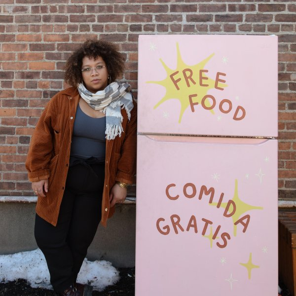 Jammella Anderson next to one of her Albany, N.Y., food fridges. Most share the same inviting verbiage: FREE FOOD. COMIDA GRATIS
