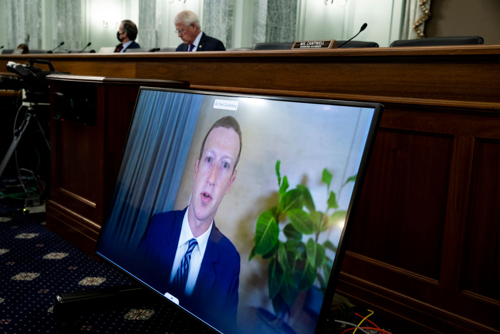 CEO of Facebook Mark Zuckerberg appears on a monitor as he testifies remotely during the Senate Commerce, Science, and Transportation Committee hearing 'Does Section 230's Sweeping Immunity Enable Big Tech Bad Behavior?', on Capitol Hill, October 28, 2020 in Washington, DC.