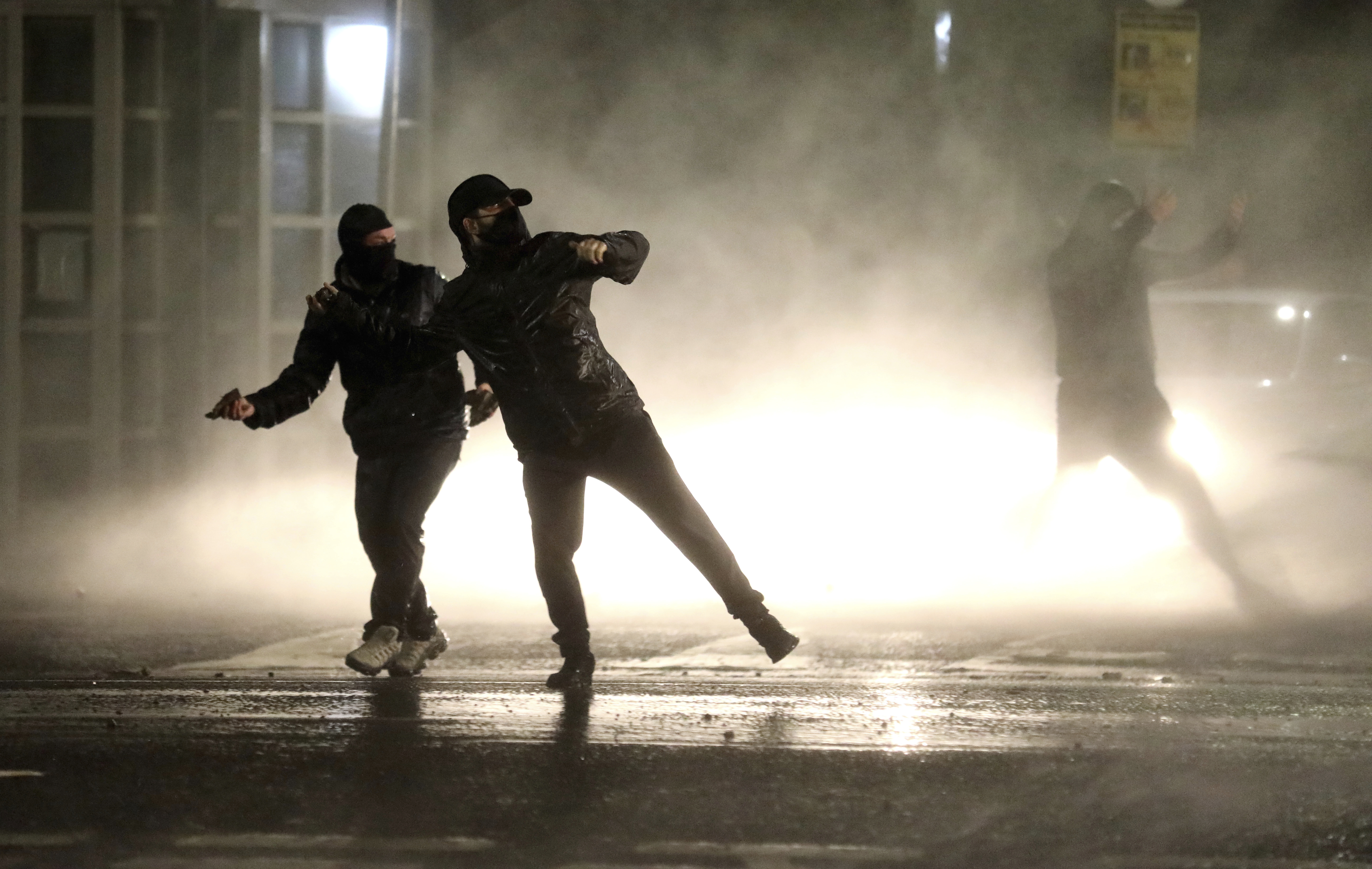 Nationalist youths confront police lines near the Peace Wall in West Belfast, Northern Ireland, Thursday, April 8, 2021.