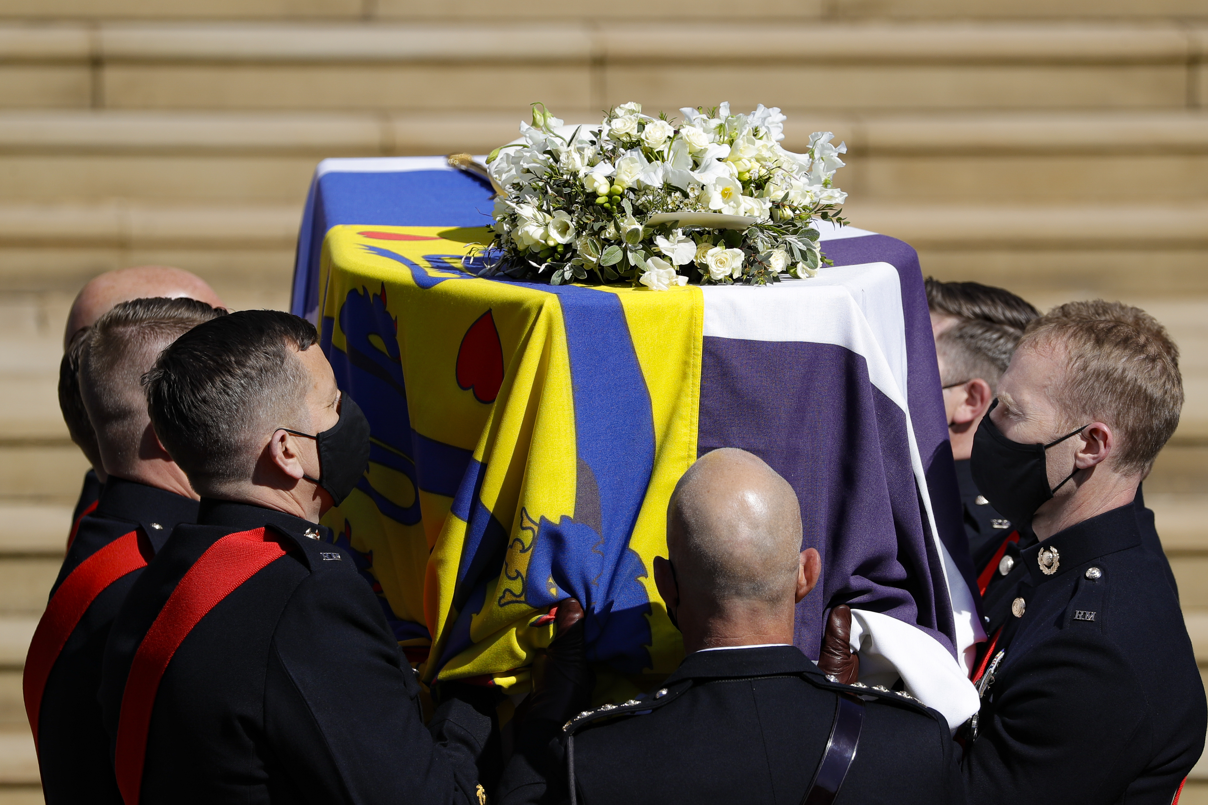 The coffin arrives at St George's Chapel for the funeral of Britain's Prince Philip inside Windsor Castle in Windsor, England, on April 17, 2021.