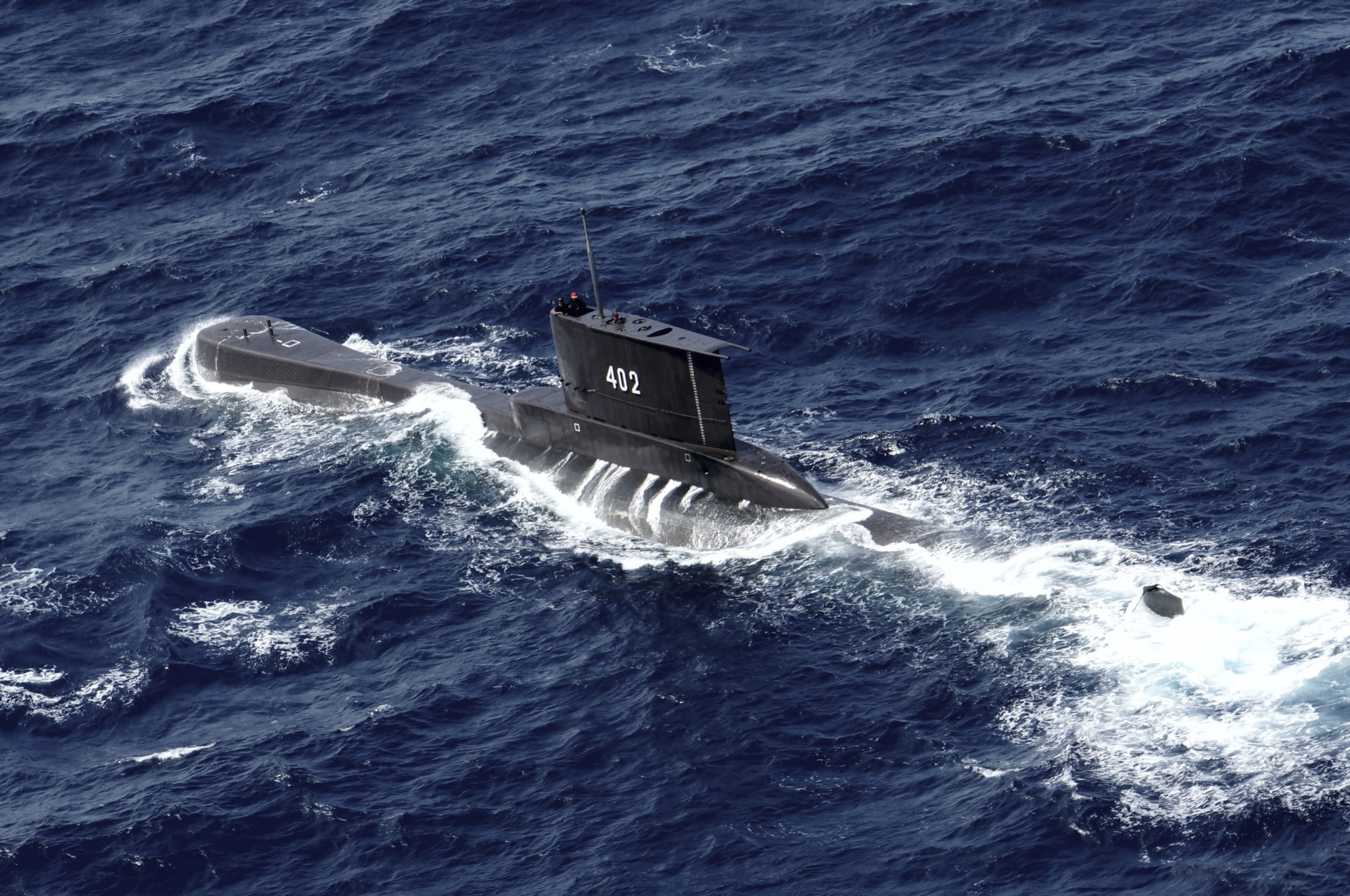Indonesian Navy submarine KRI Nanggala sails in the waters off Tuban, East Java, Indonesia, as seen in this aerial photo taken from an Indonesian Navy helicopter on Monday, Oct. 6, 2014