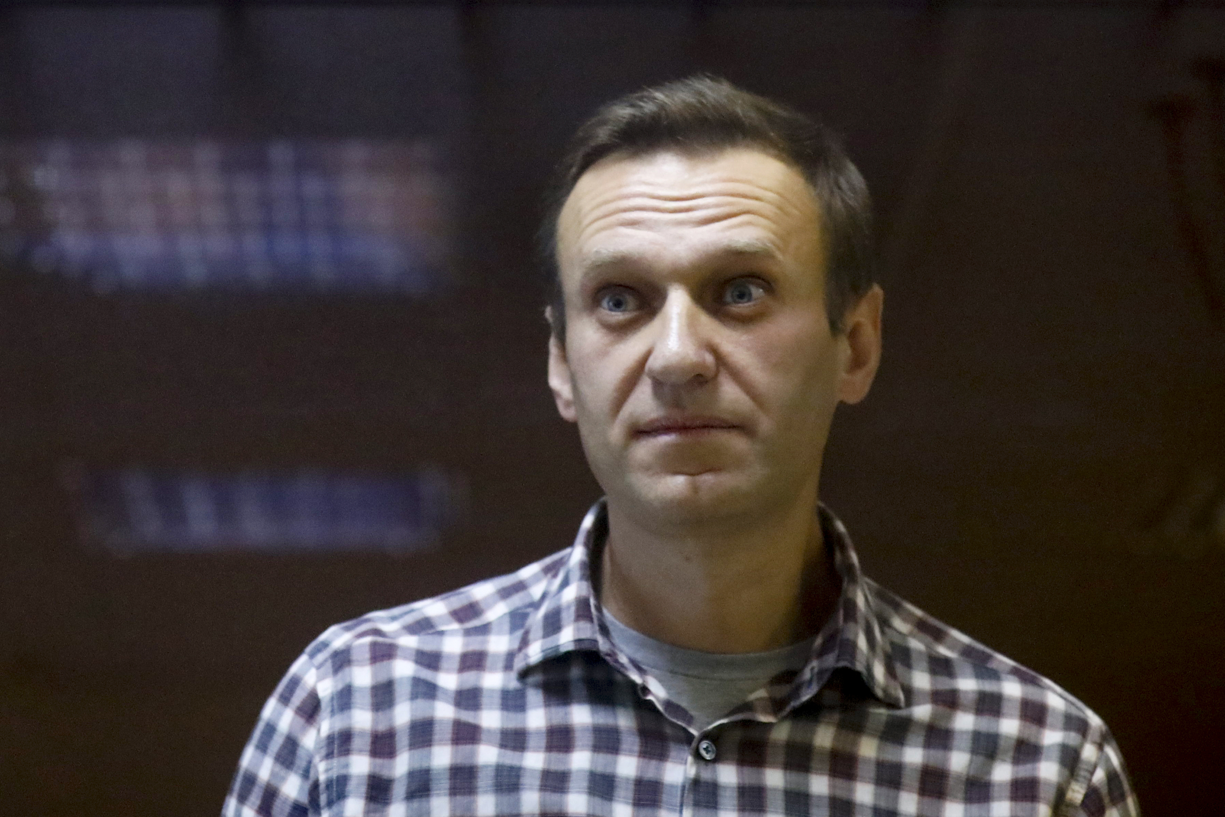 Russian opposition leader Alexei Navalny stands in a cage in the Babuskinsky District Court in Moscow, Russia, on Feb. 20, 2021 .