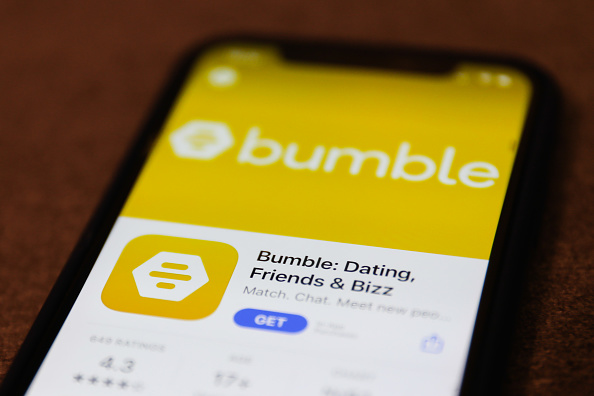 Bumble dating app logo is seen displayed on a phone screen in this illustration photo taken in Poland on February 21, 2021.