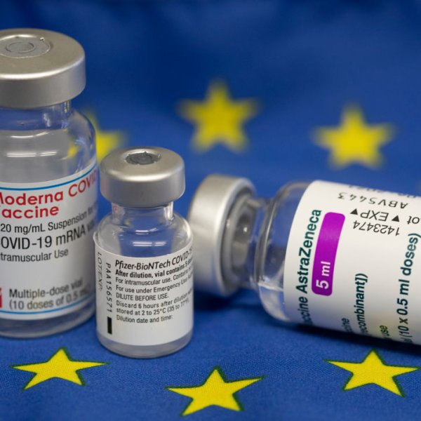 This photo illustration shows original vaccination vials from Moderna, Pfizer/BioNTech and AstraZeneca laying on a euro flag on April 14, 2021 in Bonn, Germany.