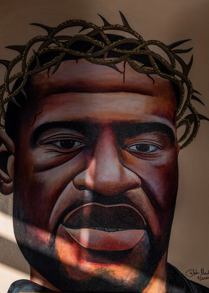 A portrait of George Floyd located in the front room of the Chicago Ave Fine Arts Center shows the breath of the artifacts that have been donated and collected by caretaker Jeanelle Austin for the George Floyd Global memorial