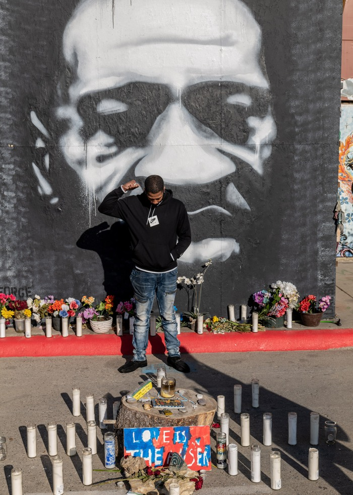 A young man pays tribute to George Floyd in Minneapolis Minnesota