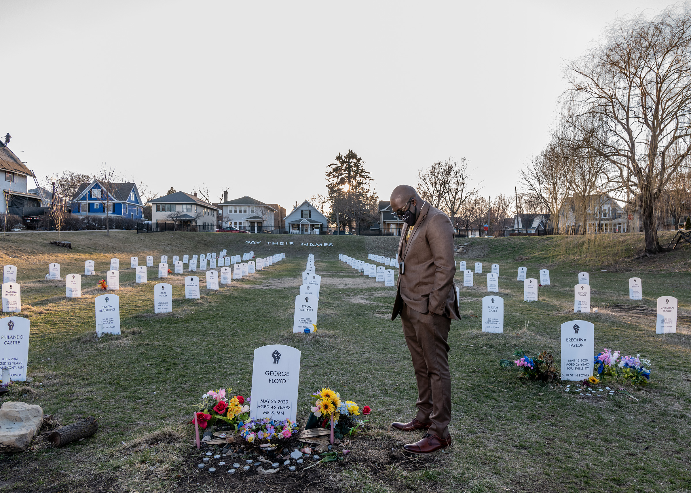 George Floyd's brother Philonise Floyd visits a protest art installation on April 1. The tombstones bear the names of Black Americans who were lynched by private citizens, fatally shot or choked by police officers, and other victims who died in police custody.