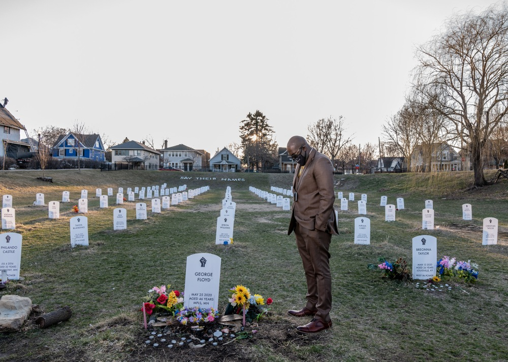 George Floyd's brother, Philonise Floyd, visits a protest art installation on April 1. The tombstones bear the names of Black Americans who were lynched by private citizens, fatally shot or choked by police officers, and other victims who died in police custody.