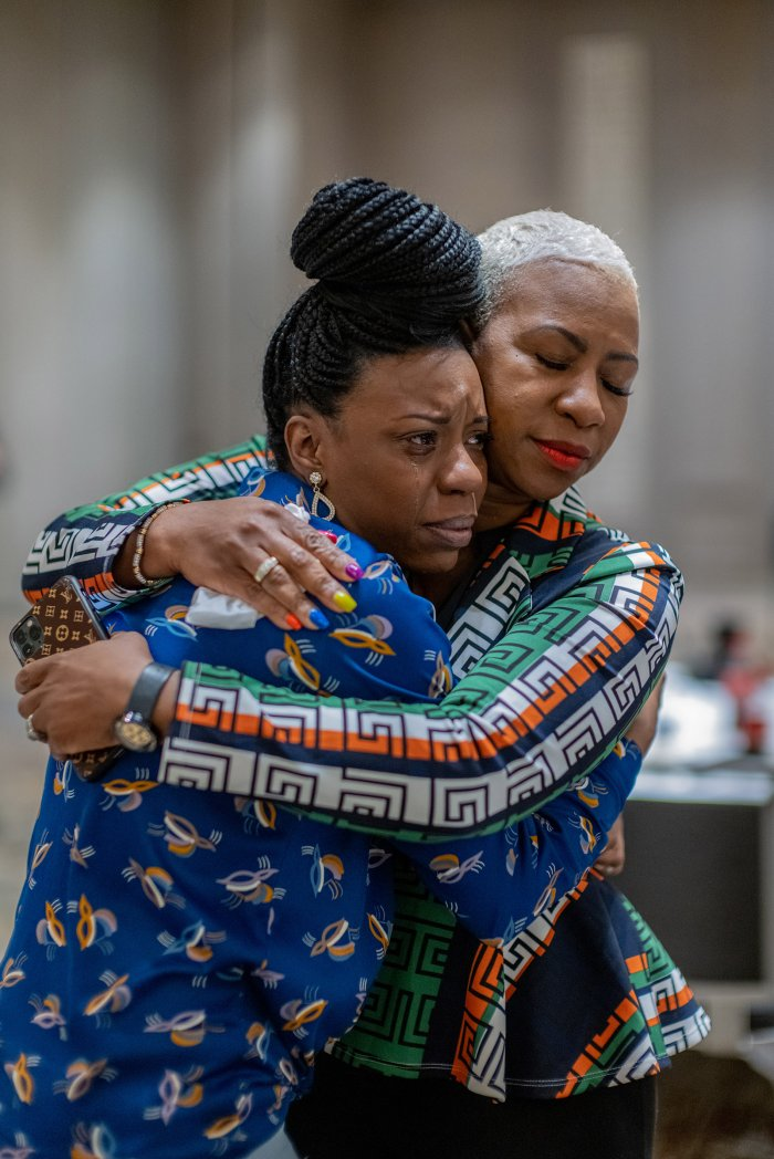 After anxiously waiting for the news, Tedra McGee hugs her mother, Shareeduh McGee, Floyd's cousin, just after the verdicts were read.