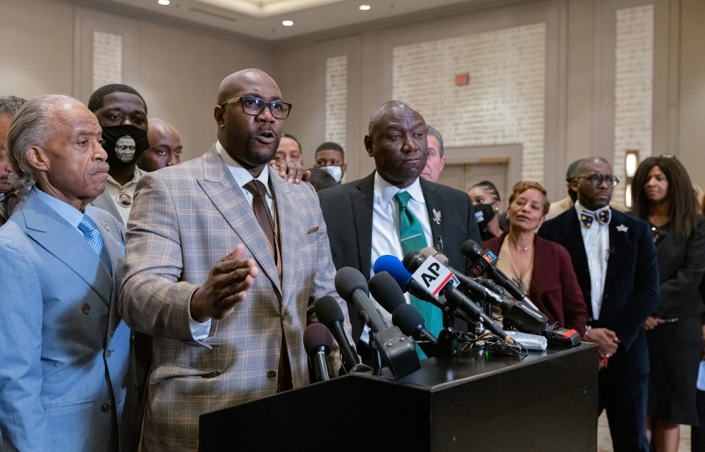 George Floyd's brother, Philonise Floyd, is flanked by the Rev. Al Sharpton, left, and Attorney Ben Crump during a news conference after the verdicts were announced.