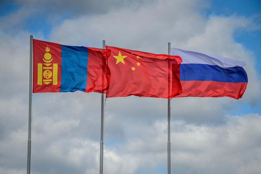 The flags of Mongolia, China and Russia fly in the wind during the Vostok-2018 (East-2018) military drills at Tsugol training ground not far from the borders with China and Mongolia in Siberia, on September 13, 2018.