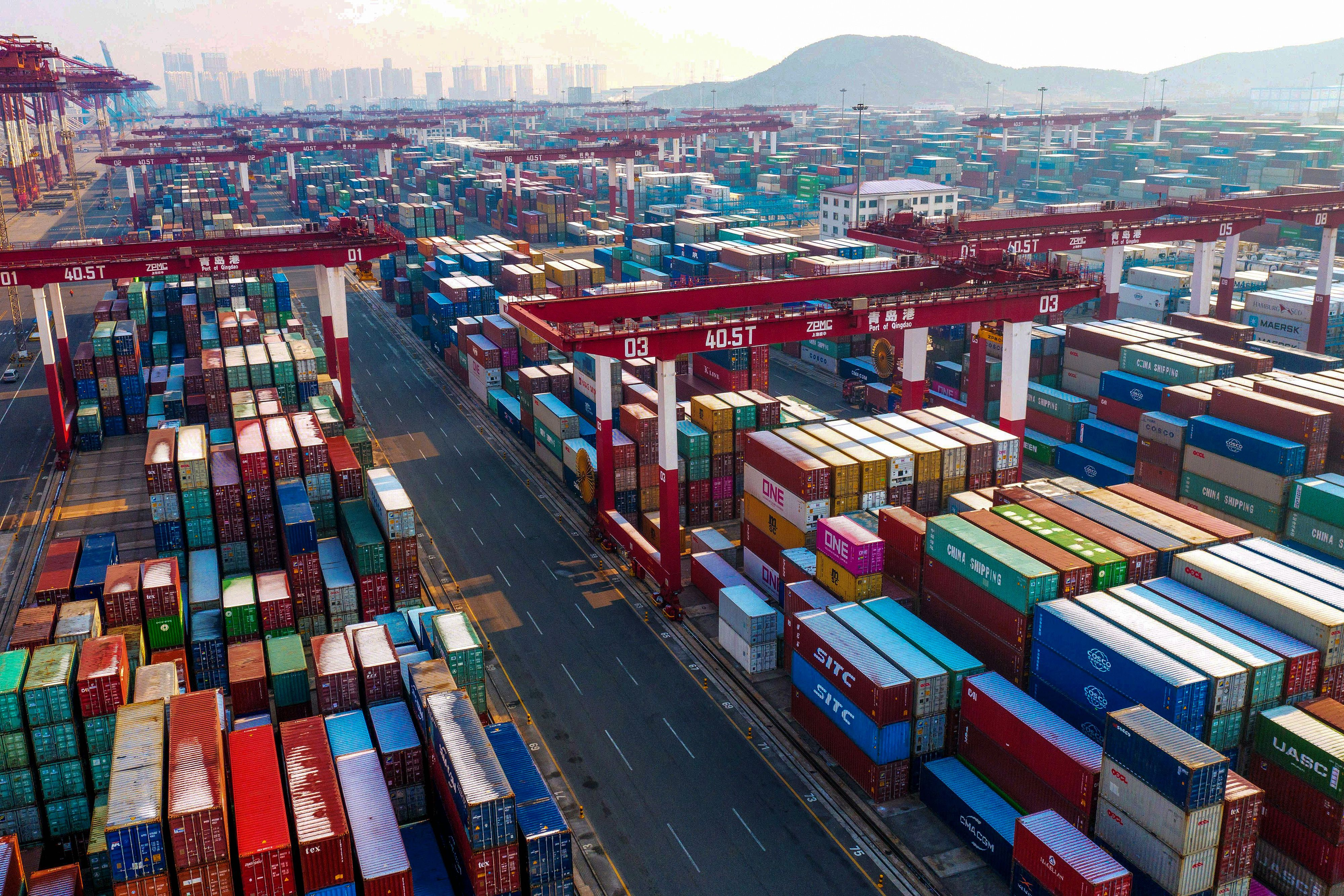 Containers are seen stacked at a port in Qingdao in China's eastern Shandong province on January 14, 2020. China's trade surplus with the United States narrowed in 2019 as the world's two biggest economies exchanged punitive tariffs in a bruising trade war
