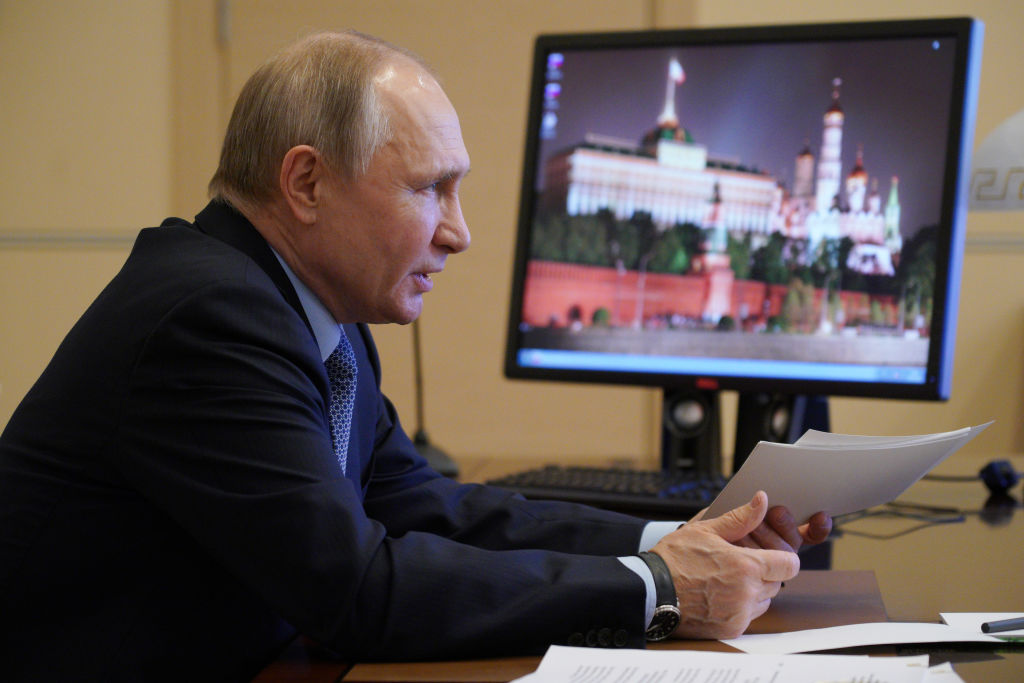 Russias President Vladimir Putin is seen in his office in Novo-Ogaryovo during a video-conference meeting of Russias Council for Interethnic Relations on March 30, 2021.