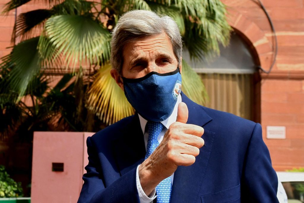 U.S. climate envoy John Kerry gestures as he arrives at the Ministry of Finance for a meeting with Indian Finance Minister Nirmala Sitharaman, in New Delhi on April 6, 2021.