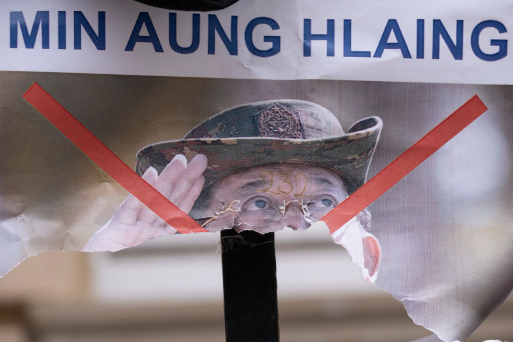 A poster showing de-facto leader of Myanmar's military government, General Min Aung Hlaing, is torn in half on railings outside the country's embassy, on 8th April 2021, in London, England.
