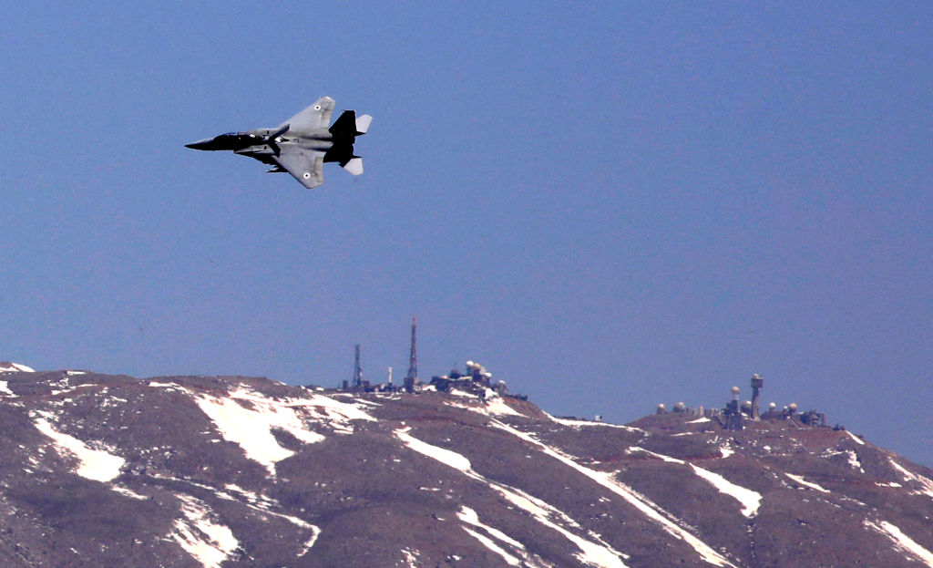A picture taken from the Israeli-annexed Golan Heights shows a F-15 fighter jet plane over Hermon Mount near the Syrian border during celebrations marking Israel's 73rd Independence Day (Yom HaAtzmaut) on April 15, 2021.