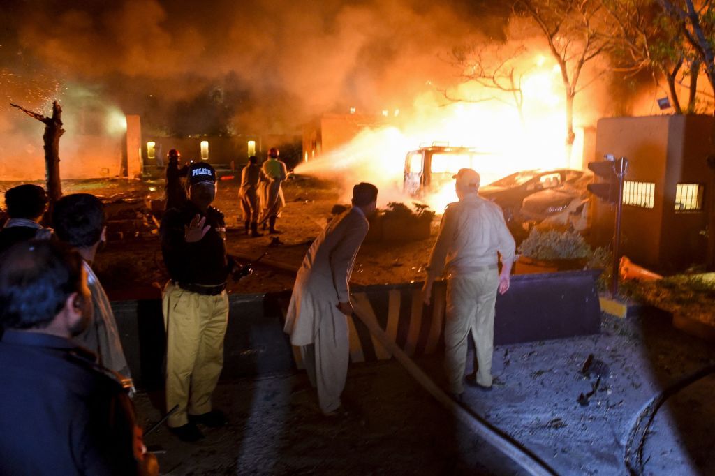 Security personnel and fire fighters arrive at the site of an explosion in Quetta on April 21, 2021.