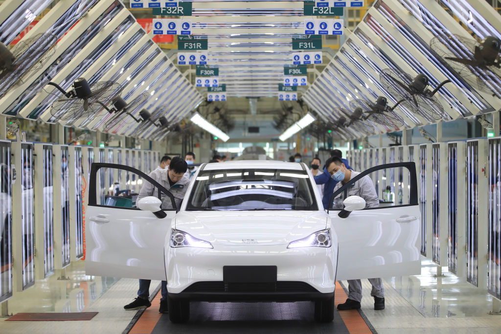 Employees work on the assembly line of Neta electric car at a factory of Hozon New Energy Automobile Co., Ltd on February 19, 2021 in Jiaxing, Zhejiang Province of China.