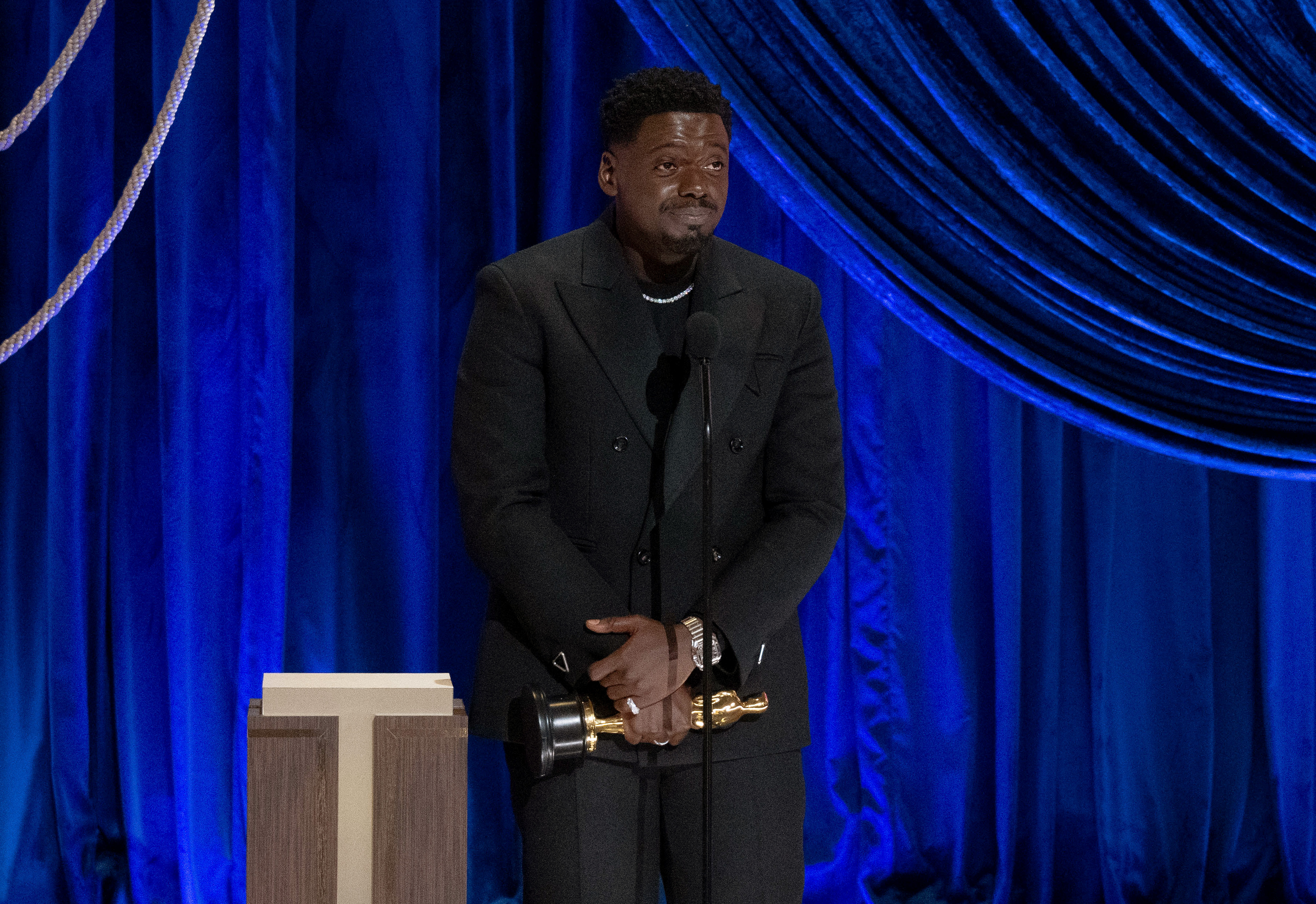 Daniel Kaluuya accepts the Oscar for Actor in a Supporting Role for 'Judas and the Black Messiah' during the 93rd Annual Academy Awards on April 25, 2021