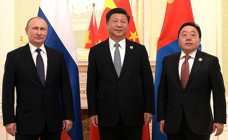 Russian President Vladimir Putin (L), Chinese President Xi Jinping (C) and President of the Republic of Mongolia Tsakhiagiin Elbegdorj (R) pose for a photo during Shanghai Cooperation Organization (SCO) summit in Tashkent, Uzbekistan on June 23, 2016.