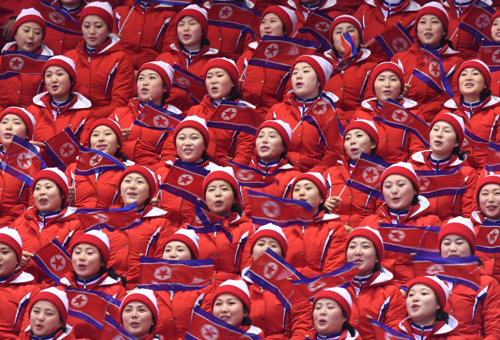 North Korean cheerleaders wave their national flags during the figure skating free skate event on day six of the Pyeongchang 2018 Winter Olympics in the Gangneung Ice Arena in Gangneung, South Korea, 15 February 2018.