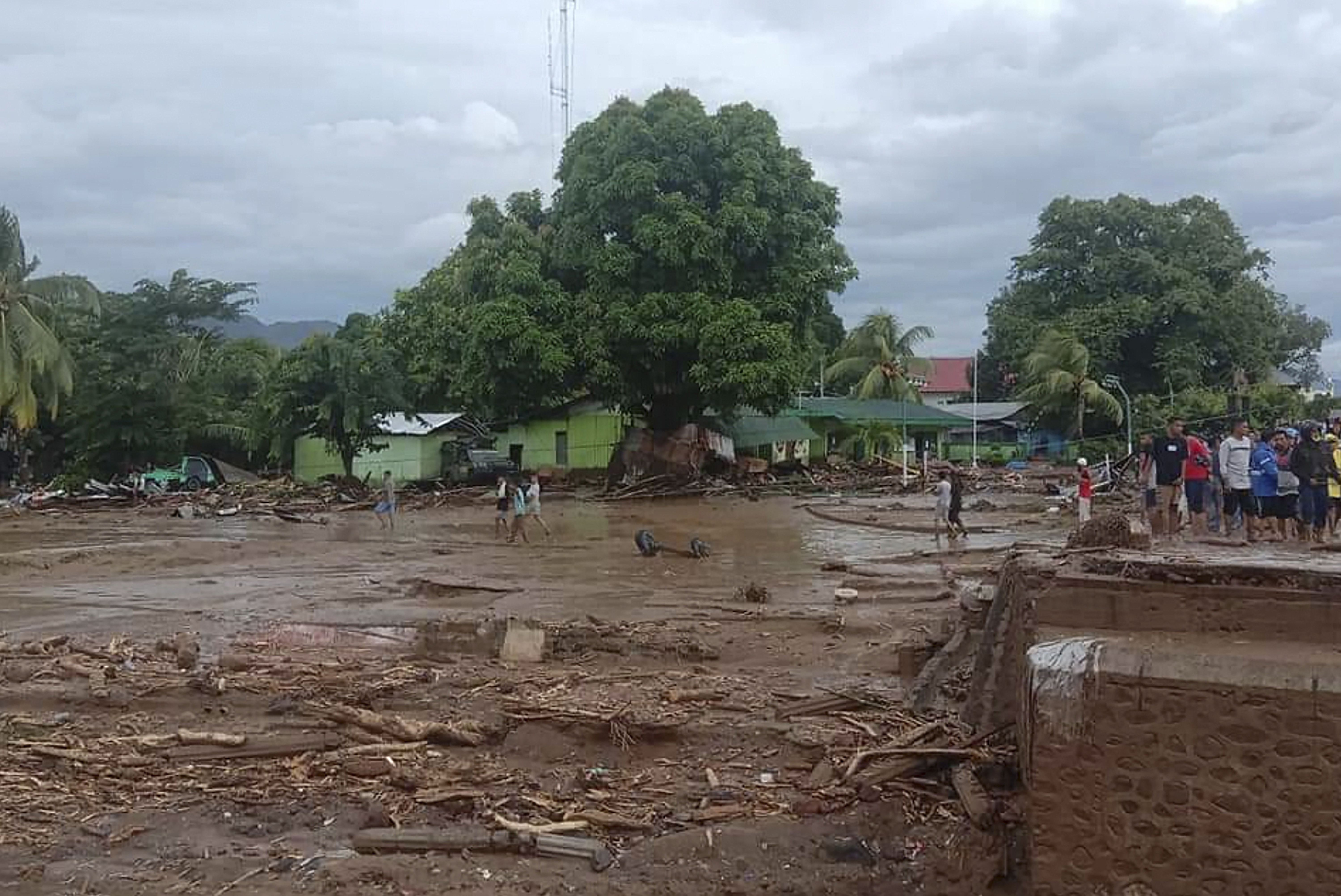 Residents inspect the damage at a village hit by flash flood in East Flores, Indonesia,  on April 4, 2021.