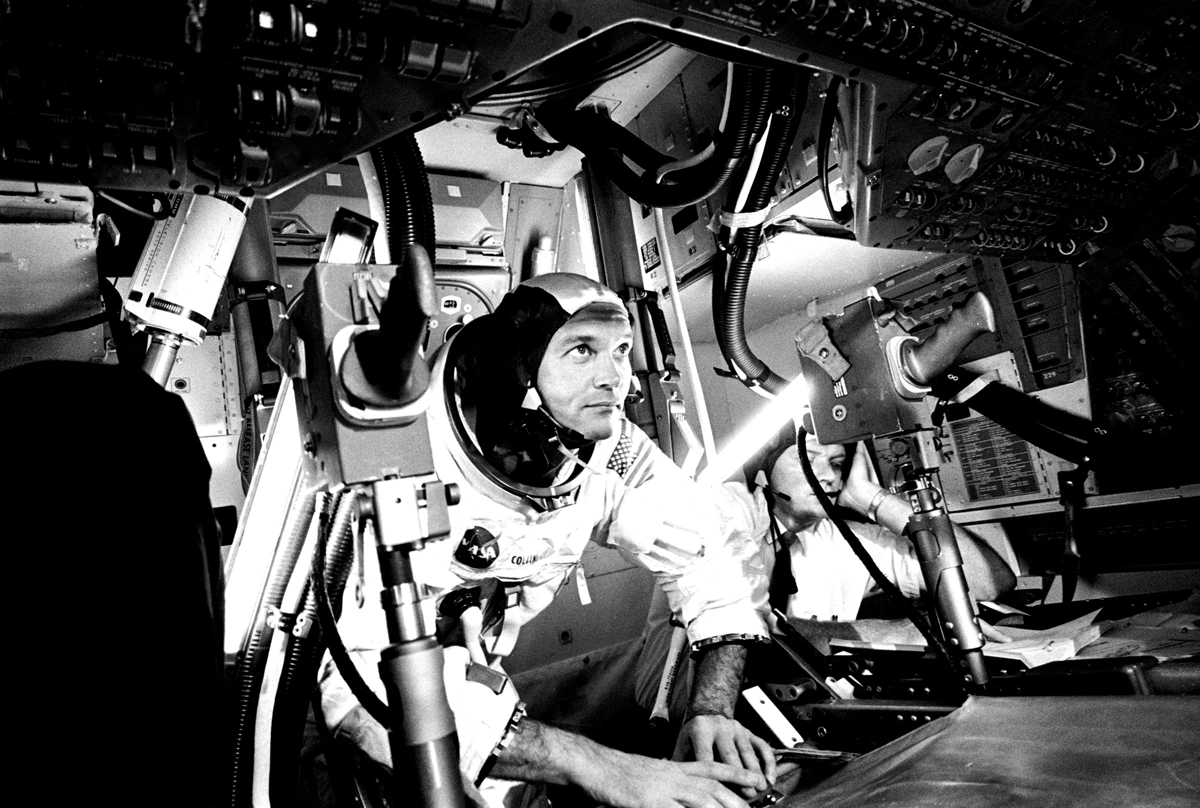 Michael Collins at the Apollo 11 Command Module, practicing docking hatch removal from CM simulator at NASA Johnson Space Center, in Houston on June 28, 1969.