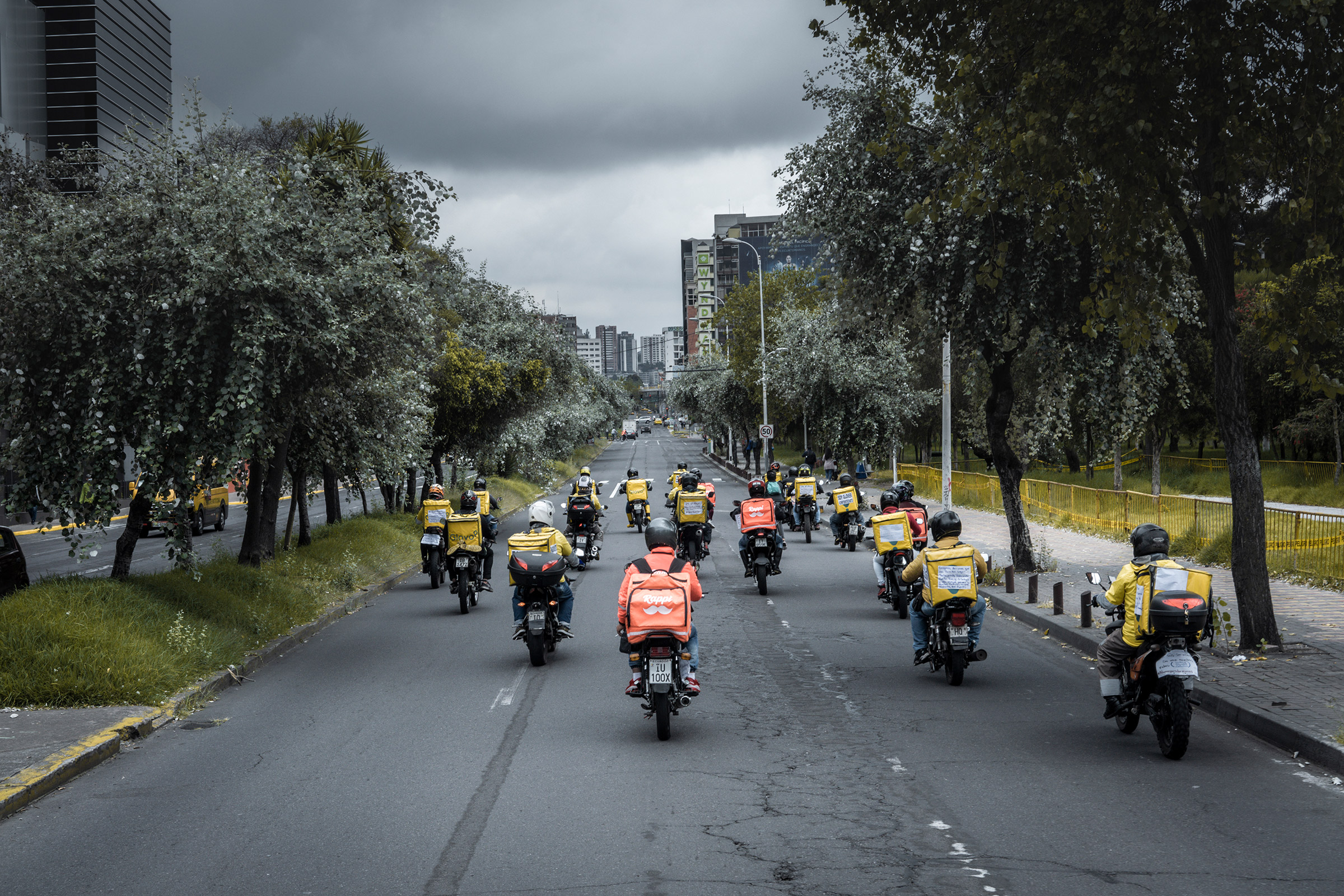 Delivery drivers ride during a global protest in May 2020, in Quito, Ecuador. Drivers from 11 countries, mainly in Latin America, protested under the motto  I won't deliver,  asking for fair payment and job security for their work.