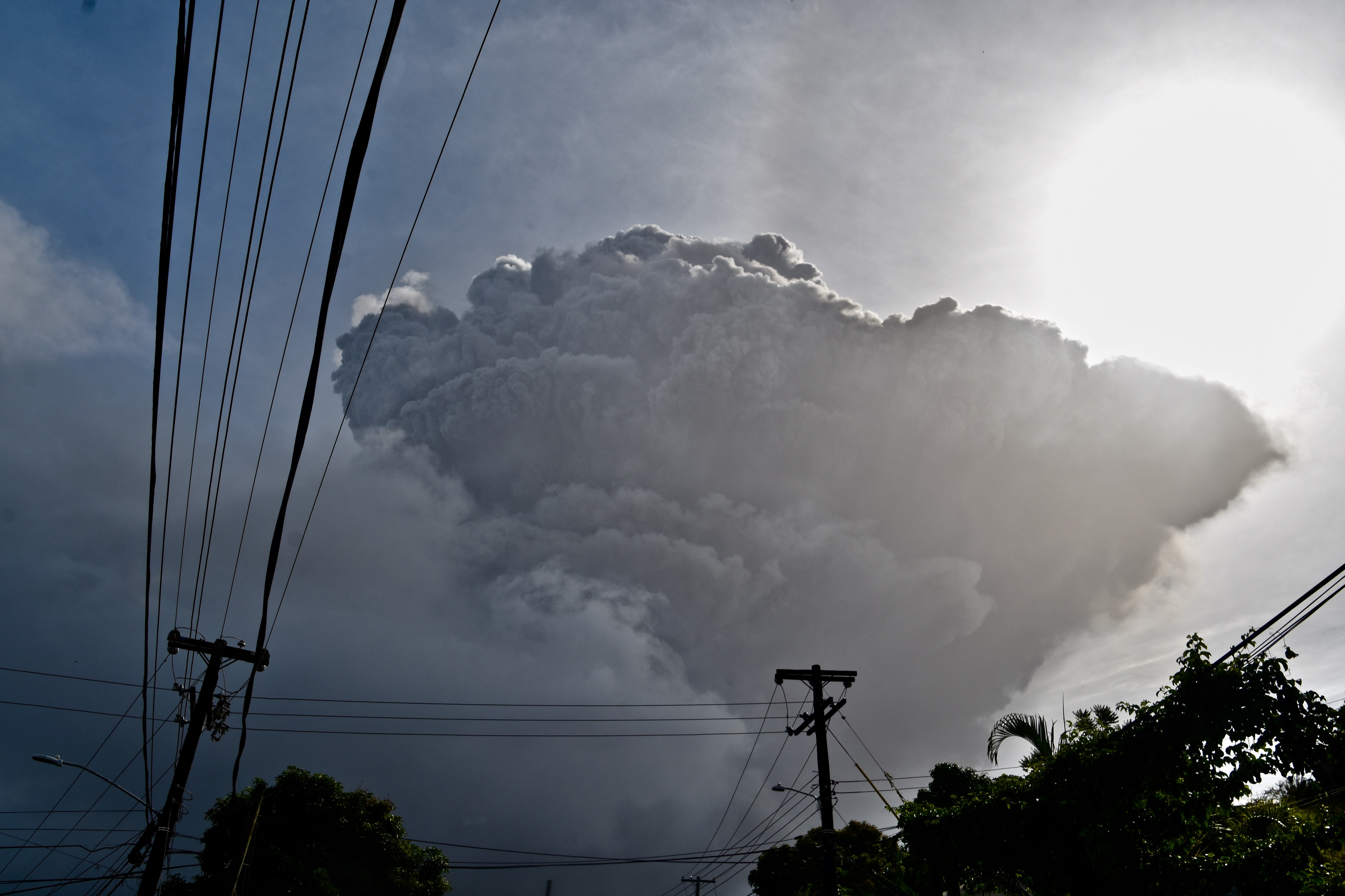 Ash rises into the air as La Soufriere volcano erupts on the eastern Caribbean island of St. Vincent, on April 9, 2021.