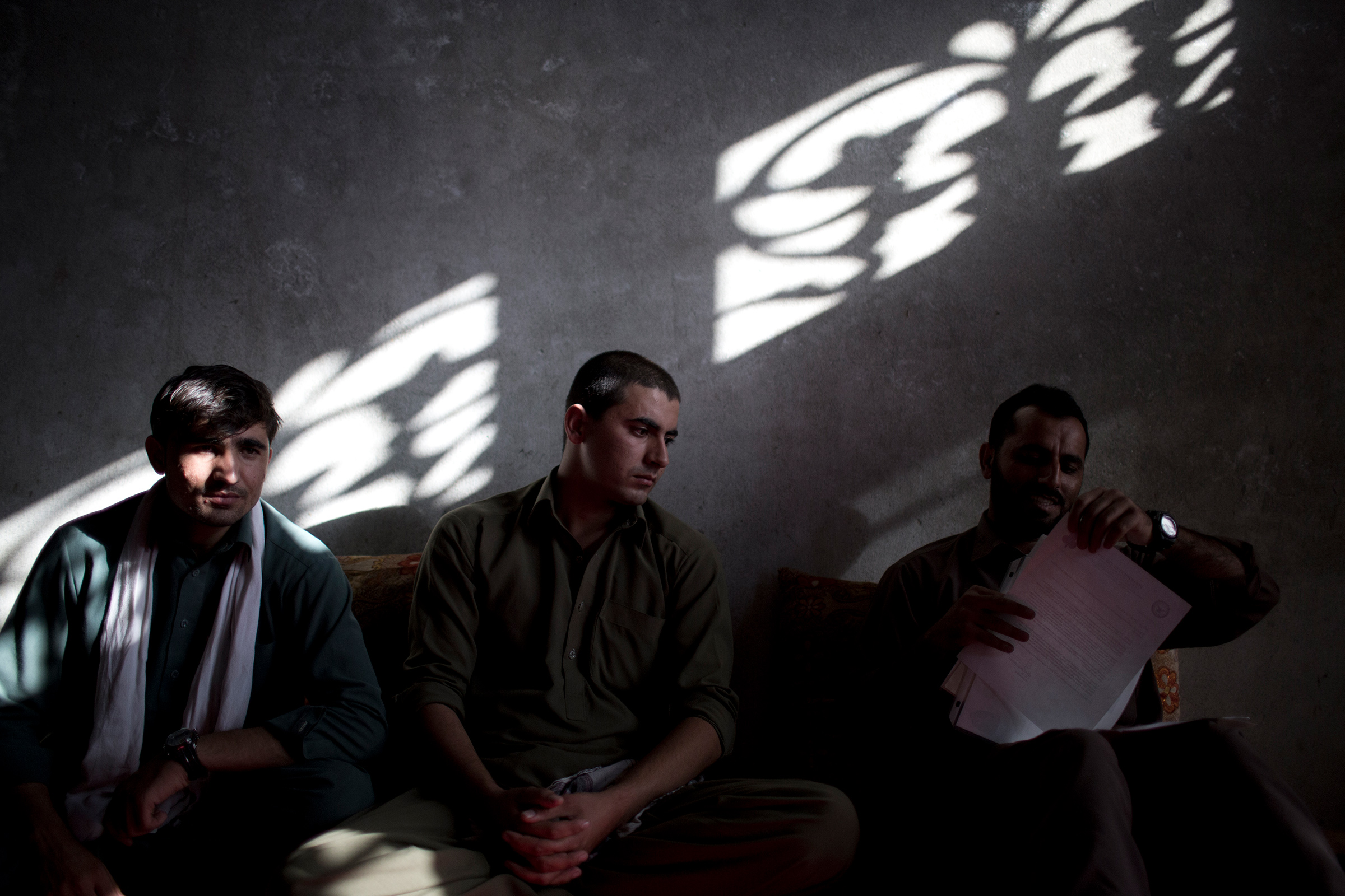 Interpreters, from left, Afiqullah, Irshadullah and Said Hussein, all working for the U.S. army, meet in Jalalabad, Afghanistan, on Oct. 20, 2012. They applied for a U.S. visa through the Afghan SIV program.