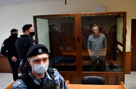 Navalny waits in a courtroom during a hearing on appellation to cancel the decision to replace his suspended sentence in the Yves Rocher fraud case with a jail term at Babushkinsky Court, Moscow, on Feb. 20.