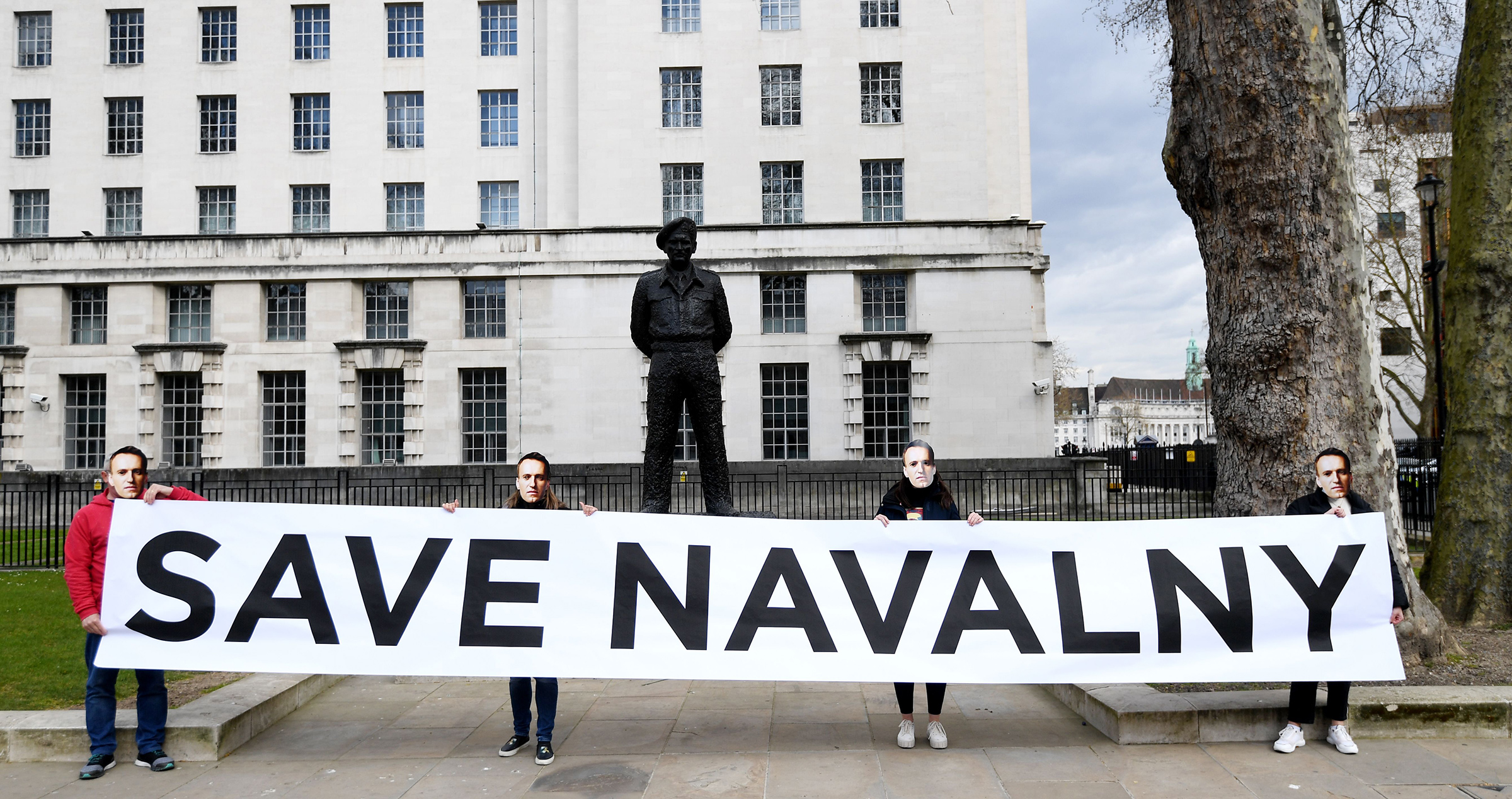 Supporters of Navalny stage a demonstration organized by the group  Art of Rebel  outside Downing Street in London on April 13, 2021.