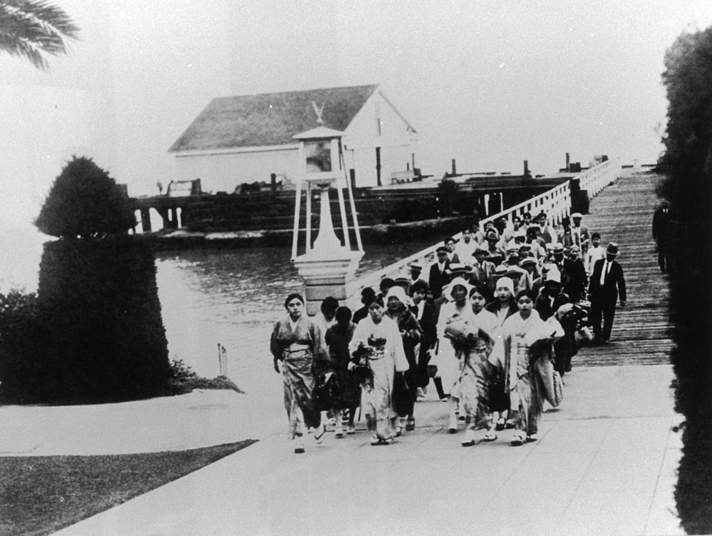 A photograph of Asian Immigrants arriving at the quarantine station at Angel Island in San Francisco Bay, circa 1911.